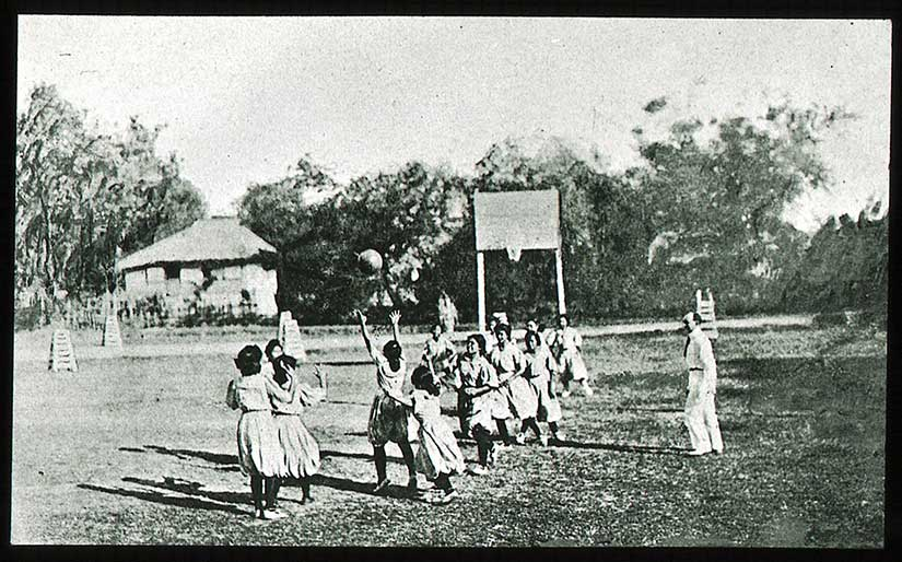 Girls playing basketball in the beginning of the twentieth century.