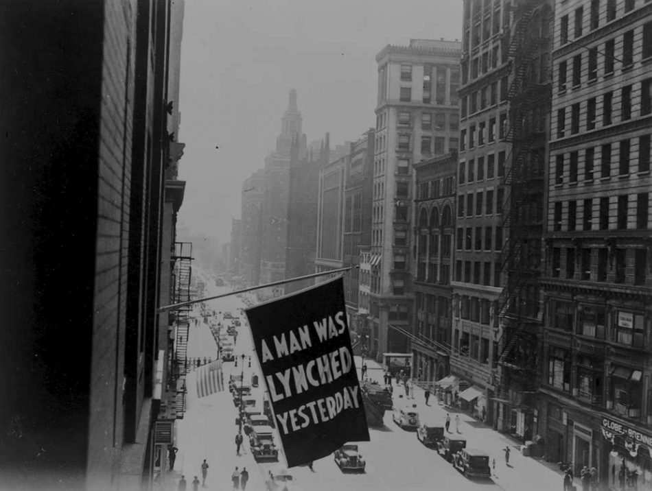 A Man Was Lynched Yesterday. Flag flying above Fifth Avenue, New York City, ca. 1938. Copyprint. NAACP Collection, Prints and Photographs Division. Reproduction Number: LC-USZC4-4734/LC-USZ62-33793 (6-10b) Courtesy of the NAACP
