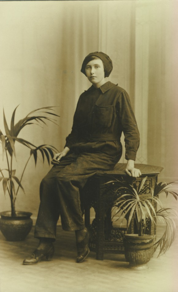 Postcard inscribed 'Maggie, our maid 1916'. Maggie is dressed for war work. (Author's collection)