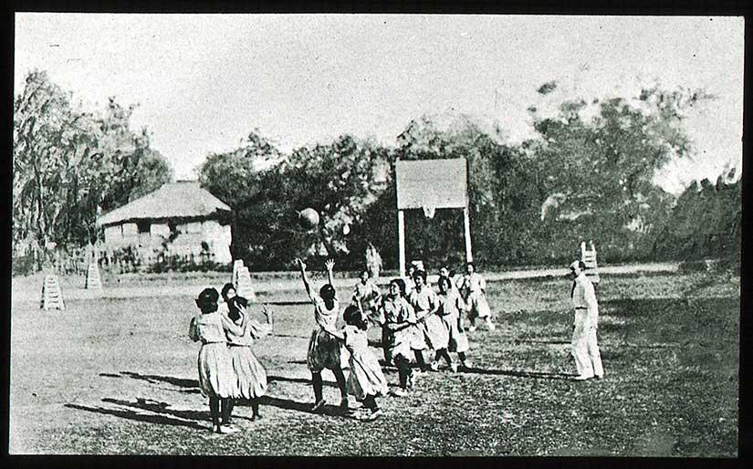 Girls playing basketball in the beginning of the twentieth century.