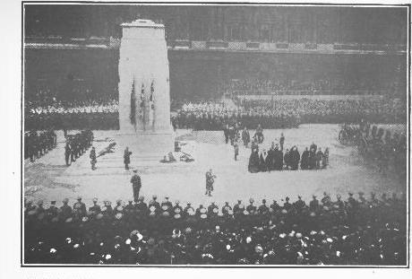 AT THE CENOTAPH IN WHITEHALL, LONDON, WHERE THE KING AND DIONITARTKS  OF THE EMPIRE JOINED THE ARMISTICE DAY THRONG IN PAYING TRIBUTE TO AN UNKNOWN BRITISH SOLDIER  (© Colonial Press Service and Underwood & Underwood)